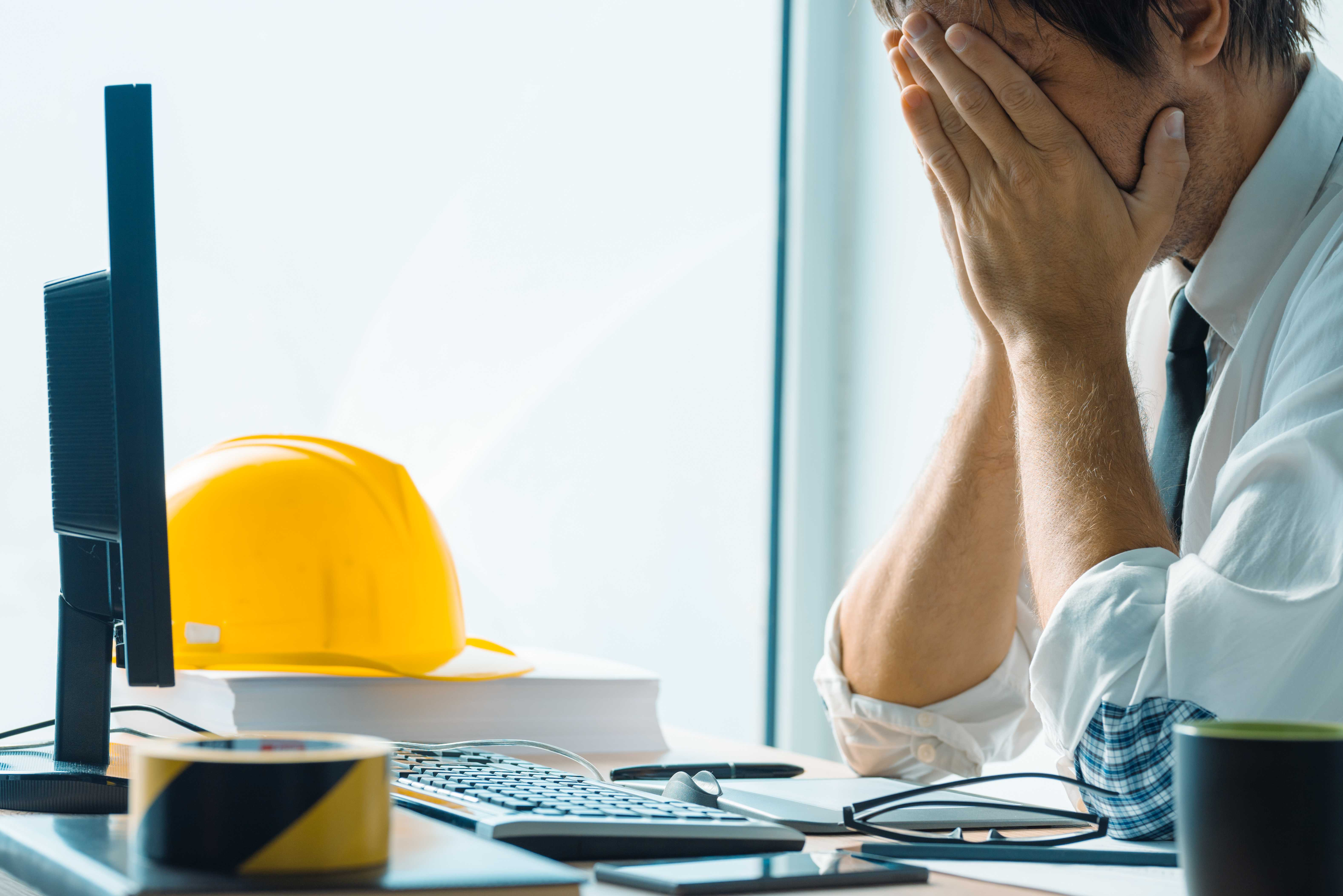 worried-interior-design-professional-working-in-of-P2VN2HY