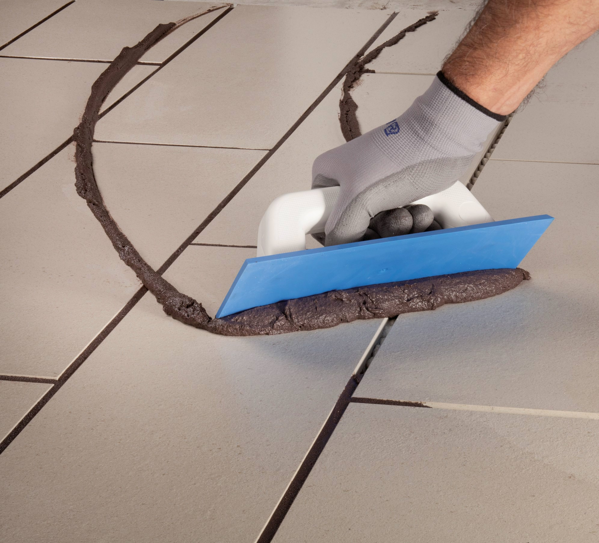 Kerapoxy CQ  being applied to installed tiles