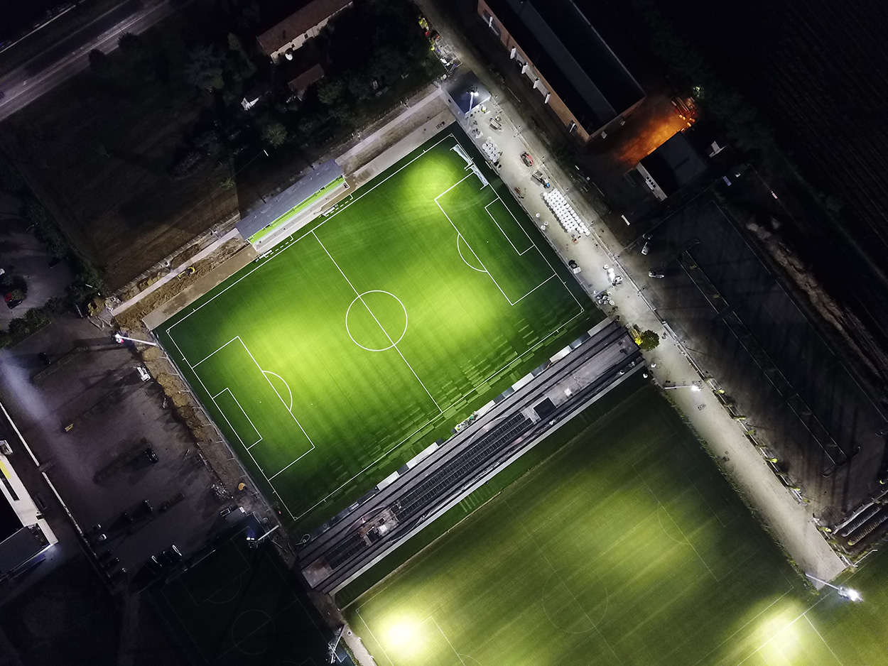 A night-time view from above of the pitch.