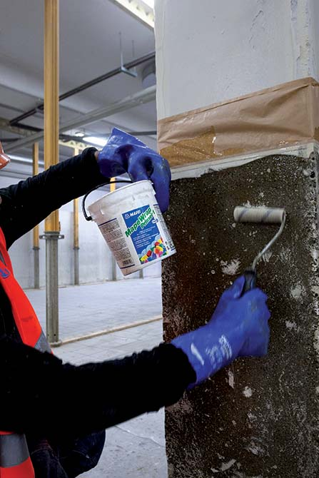 Priming the surfaces with MAPEWRAP PRIMER - Mapei's FRP-base MapeWrap for structural strengthening of IN's store in Cologno Monzese Milano Italy (1)