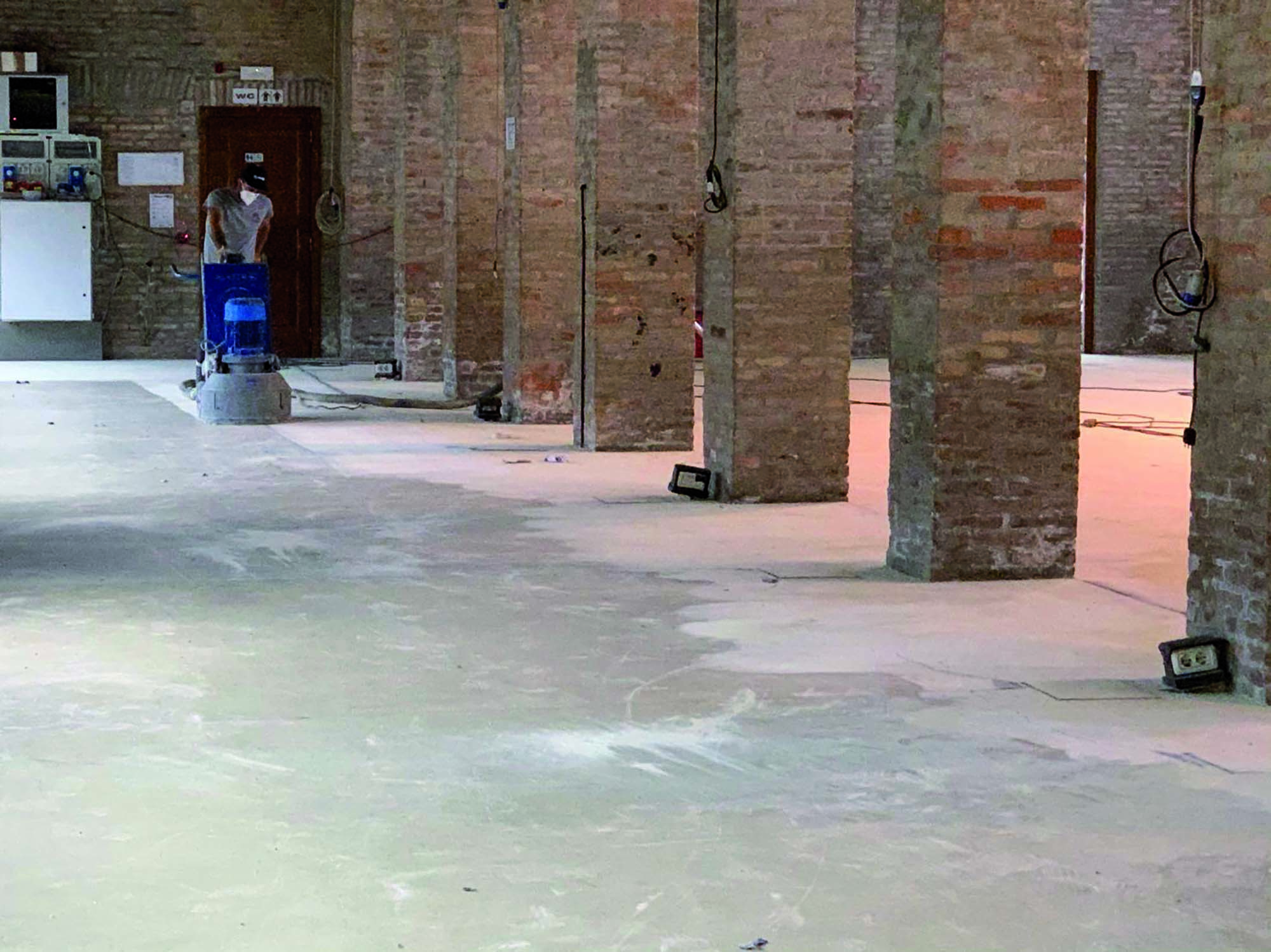 Almagia Ravenna Italy - Mapei products - Before applying MAPEFLOOR SYSTEM 33 for resin floors, the substrates were grinded with a diamond grinding disk.