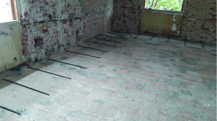 Mapei jobsite in an Italian villa - Detailed view of the extrados of one of SAP floor-slabs before placing PLANITOP HPC FLOOR 46. strengthening and seismic upgrading work (1)