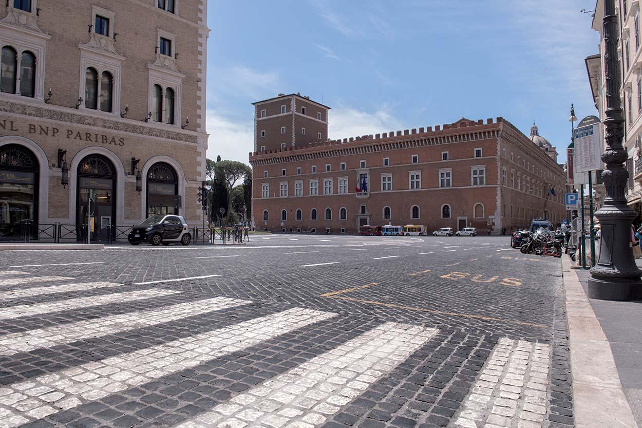 """The """"green"""" pedestrian crossing in Via Battisti made from black sanpietrini cobblestones and white travertine."""